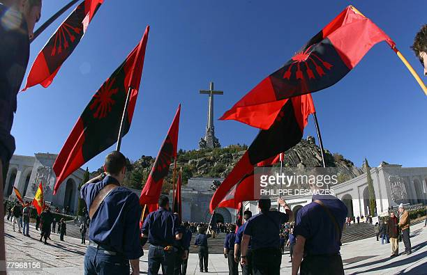 Members of the Falange party march holding the Falange flags towards the tomb of Jose Antonio Primo de Rivera the founder of the Spanish rightwing...