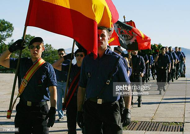Members of the Falange party march towards the tomb of Jose Antonio Primo de Rivera the founder of the Spanish rightwing movement outside the...