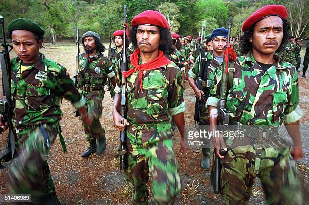 Members of the Falintil the armed wing of the East Timorese proindependence movement prepare for a falgraising ceremony at their jungle hideout in...