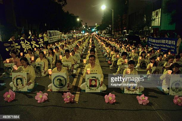 Members of the Falun Gong aka Falun Dafa spiritual group attend a silent protest outside of the Chinese Consulate on October 15 2015 in Los Angeles...
