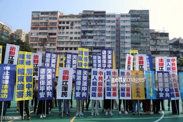 Members of the Falungong spiritual group a group banned in mainland China gather to protest at a playground in the Sham Shui Po district in Hong Kong...