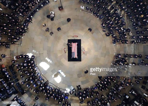Members of the family of the late US Sen John McCain RAriz walk to his casket as he lies in state in the US Capitol Rotunda on August 31 2018 in...