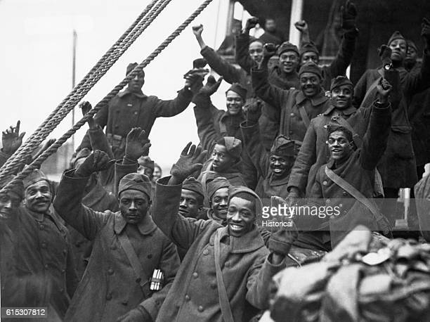 """Members of the famous 369th Colored Infantry, formerly 15th N.Y. Regulars, arrive in New York City. """"Back to little old New York."""" 1919."""