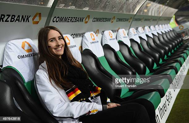 Members of the Fan Club of the German National football team sit on the trainer bank as they make a stadium tour prior to the International friendly...