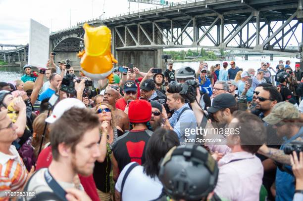 Members of the far right and counter protesters argue their points in a high tension debate during the Far Right organized End Domestic Terrorism...