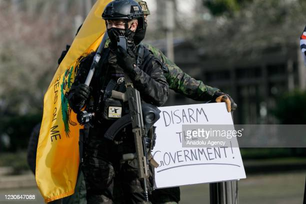 Members of the far-right extremist movement Boogaloo Bois, stage a demonstration at Oregons State Capitol in Salem, Oregon, United States on January...