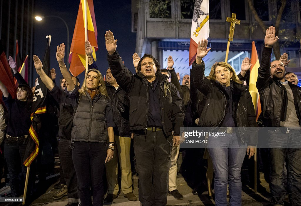 Members of the far-right Falange movement raise their hands for a fascist salute during a demonstration rally marking the 76th anniversary of the death of Jose Antonio Primo de Rivera, the founder of the Spanish right-wing movement, in the center of Madrid on November 24, 2012, before starting their 'Crown march' from Madrid to the Valle de los Caidos (Valley of the Fallen) where the tombs of Spain's former dictator General Francisco Franco and Primo de Rivera lie.