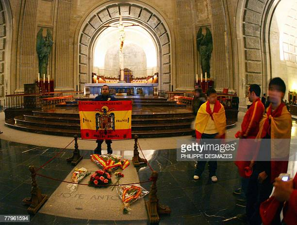 Members of the farright Falange party pose 17 November 2007 next to the tomb of Jose Antonio Primo de Rivera its founder and the ideological mentor...