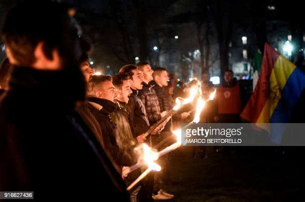 TOPSHOT Members of the farright movement CasaPound holds torches during the Day of Remembrance of the martyrs of the Foibe Istriane and the exodus of...