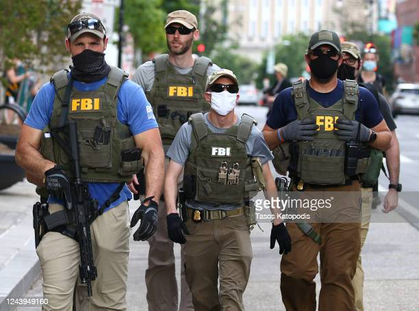 Members of the FBI carry weapons as protests continue against police brutality and the death of George Floyd, on June 3, 2020 in Washington, DC....