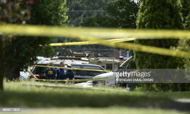 Members of the FBI gather after a shooting during a practice of the Republican congressional baseball at Eugene Simpson Statium Park June 14 2017 in...