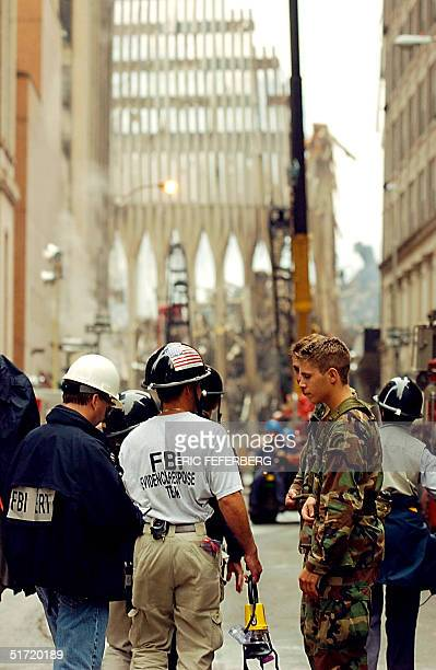 Members of the FBI have their ID's checked on the street leading to the World Trade Center 21 September 2001 in New York Rescue and recovery efforts...