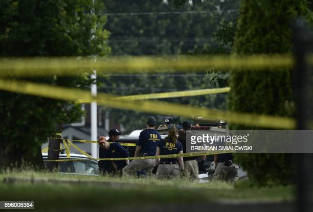 Members of the FBI inspect the crime scene after a shooting during a practice of the Republican congressional baseball at Eugene Simpson Statium Park...