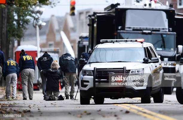Members of the FBI survey the street on October 28 2018 outside of the Tree of Life synagogue after a shooting there left 11 people dead in the...
