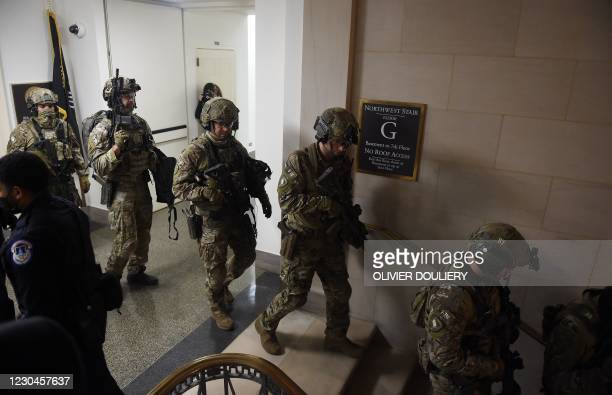 Members of the FBI Swat team secure the corridors of the US Capitol in Washington, DC on January 6, 2021. - Donald Trump's supporters stormed a...