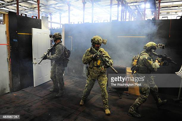 Members of the FBI's Hostage Rescue Team demonstrate close quarter battle training at the Tactical Firearms Training Center on Tuesday April 08 2014...