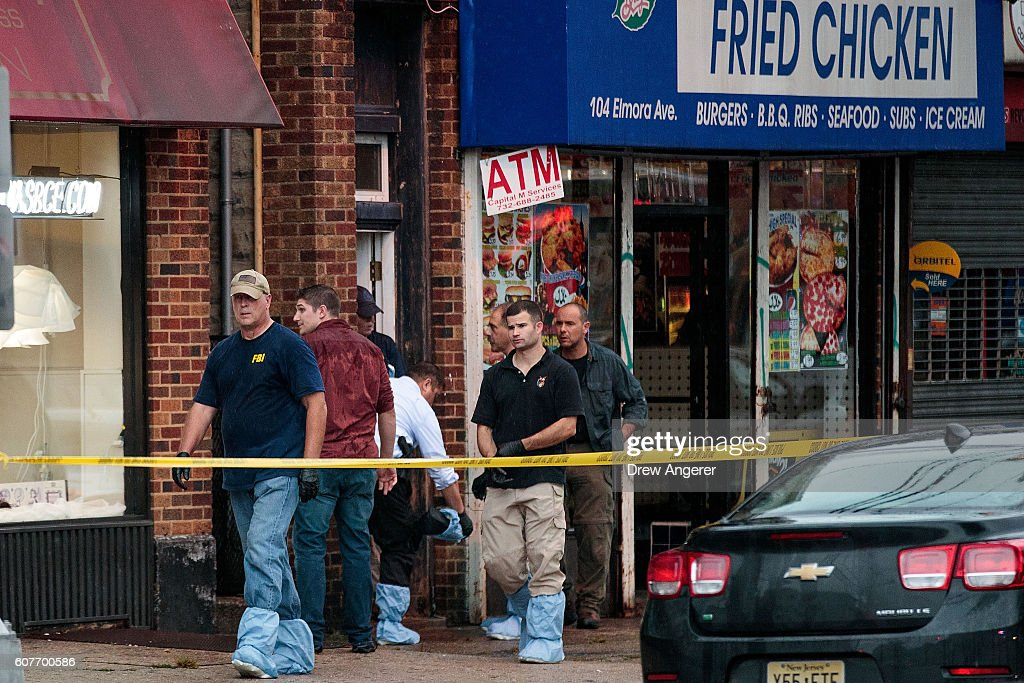 Members of the Federal Bureau of Investigation (FBI) and other law enforcement officials investigate a residence in connection to Saturday night's bombing in Manhattan on September 19, 2016 in Elizabeth, New Jersey. This morning law enforcement released a photograph of 28-year-old Ahmad Khan Rahami, who they are seeking in connection to the attack in Chelsea. First American Fried Chicken, on the ground floor of their home on Elmora Avenue, is owned by Rahami's father Muhammad Raham.