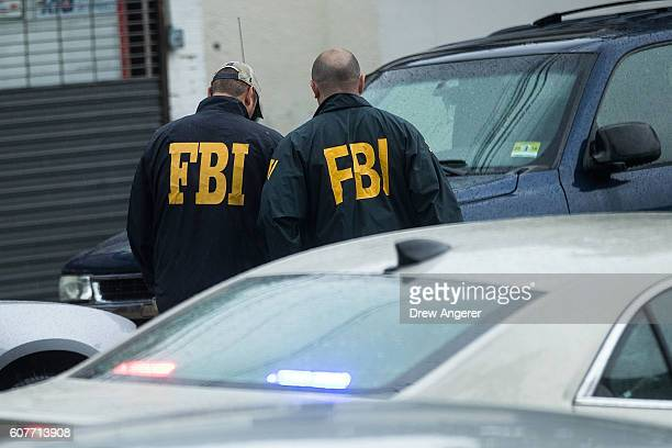 Members of the Federal Bureau of Investigation investigate a residence in connection to Saturday night's bombing in Manhattan September 19 2016 in...