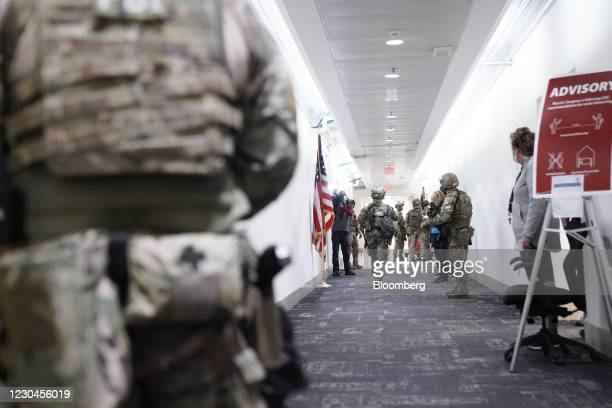 Members of the Federal Bureau of Investigation swat team patrol the Longworth House Office building after a joint session of Congress to count the...