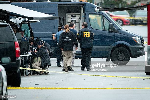 Members of the Federal Bureau of Investigation work at the site where Ahmad Khan Rahami who was wanted in connection to Saturday night's bombing in...