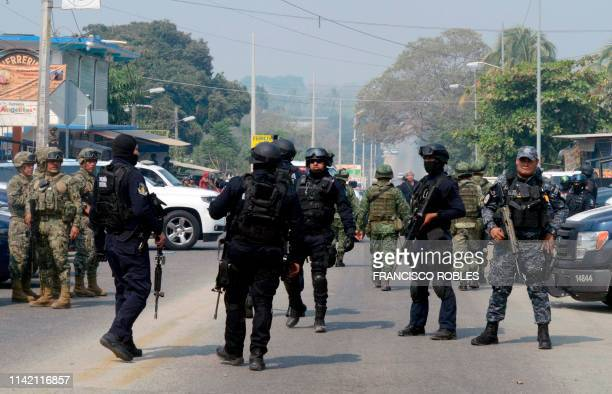 Members of the Federal Police and soldiers of the Mexican Army are seen at the scene where a criminal group and members of selfdefence groups faced...