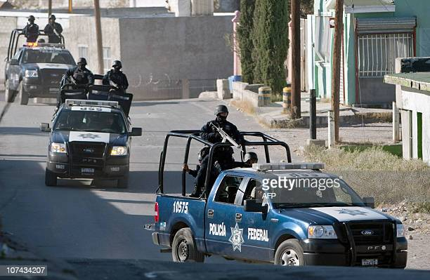Members of the Federal Police arrive to the crime scene after three members of the Municipal Police were killed in Ciudad Juarez Mexico on December 8...