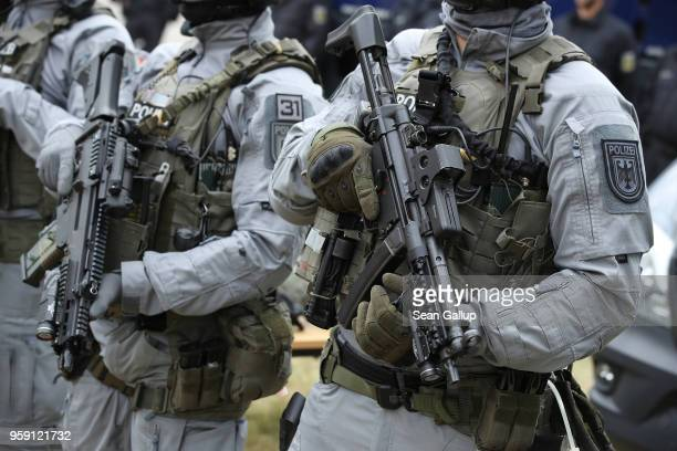 Members of the federal police BFE Plus anti-terror unit hold Heckler & Koch G36C and MP5 submachine guns prior to a visit by German Interior Minister...