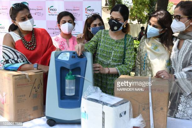Members of the Federation of Indian Chambers of Commerce and Industry and the Ladies Organisation along with chairperson Manjot Dhillon display...