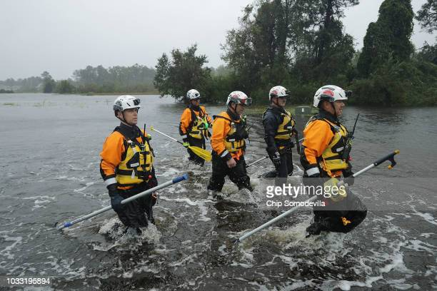 Members of the FEMA Urban Search and Rescue Task Force 4 from Oakland California search a flooded neighborhood for evacuees during Hurricane Florence...