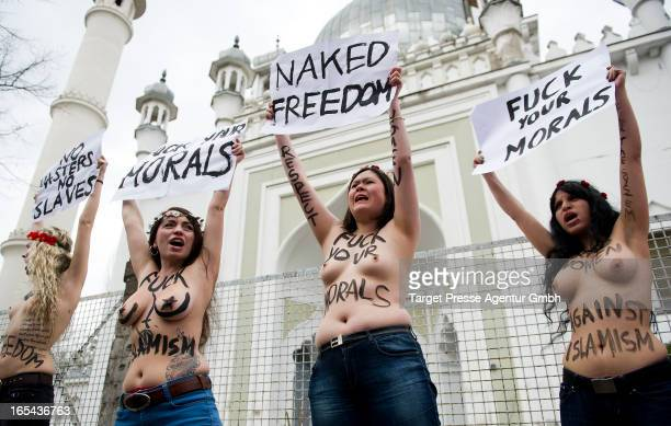 Members of the FEMEN activist group bear their breasts in protest at the AhmadiyyaMoschee on April 4 2013 in Berlin Germany The women under the...