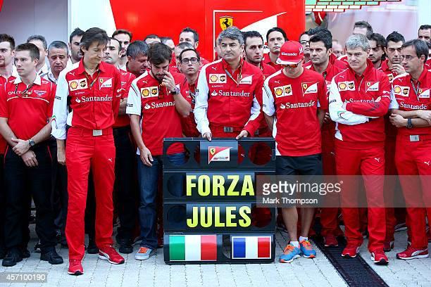 Members of the Ferrari and Marussia teams including Fernando Alonso Kimi Raikkonen and Ferrari Team Principal Marco Mattiacci pay tribute to Jules...