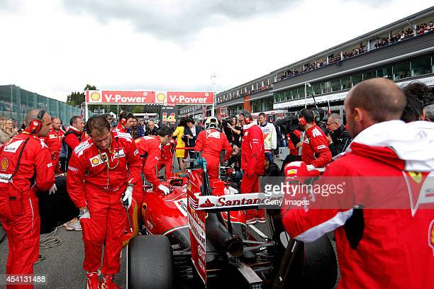 Members of the Ferrari team prepare on the grid before the Belgian Grand Prix at Circuit de SpaFrancorchamps on August 24 2014 in Spa Belgium