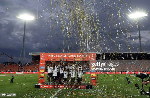 Members of the Fiji team celebrate after winning the final gold medal match at the World Rugby Sevens Series between Fiji and South Africa at Waikato...