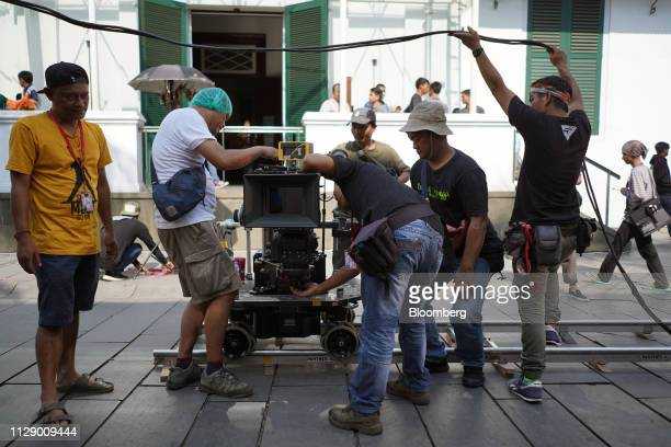 Members of the film crew prepare a camera dolly mounted on a track during the production of the film Sin in Jakarta Indonesia on Thursday Feb 14 2019...