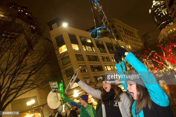 Members of the Filthy Fem Corps perform in honor of International Women's Day at Westlake Center on March 8 2017 in Seattle United States The rally...