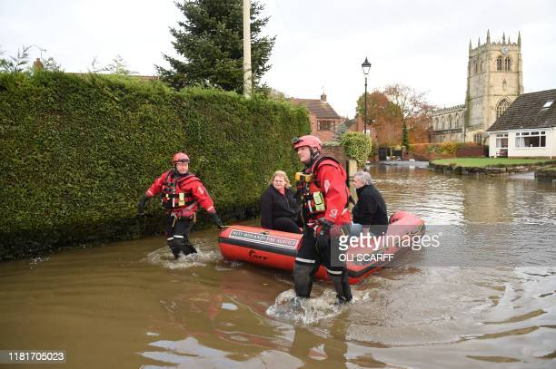 Members of the Fire and Rescue service help residents in the village of Fishlake near Doncaster northern England on November 11 2019 following heavy...