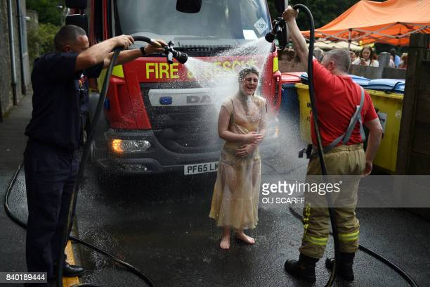 Members of the fire brigade hosedown competitors at the 10th annual World Gravy Wrestling Championships held at the Rose 'n' Bowl Pub near Bacup...