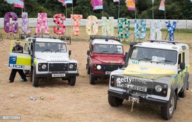Members of the Fire Police and Ambulance service arrange their Land Rovers for a group photograph at the Glastonbury Festival site at Worthy Farm in...