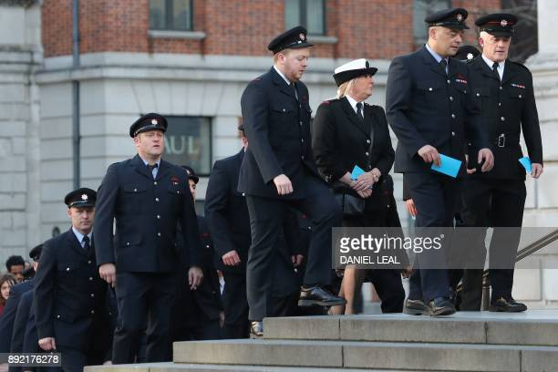 Members of the fire service arrive at St Paul's cathedral for a Grenfell Tower National Memorial service on December 14 2017 in central London The...