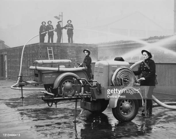 Members of the first all female Auxiliary Fire Service fire station in Northumberland undergo training with a portable 80lb water pressure hose and...