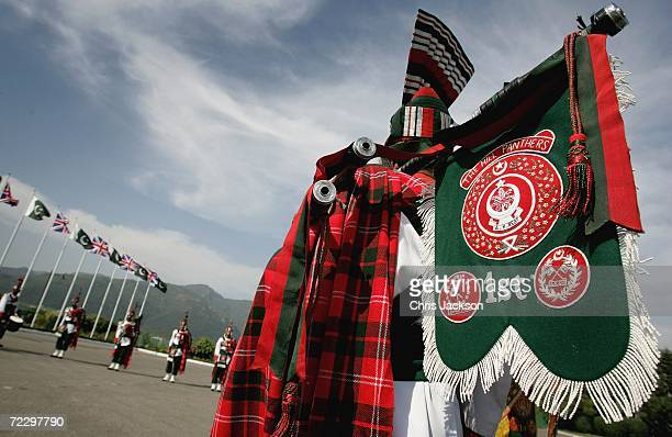 Members of the first Hill Panthers stand on parade at the Prime Minister's House on day two of a week long Royal tour of the country on October 30...