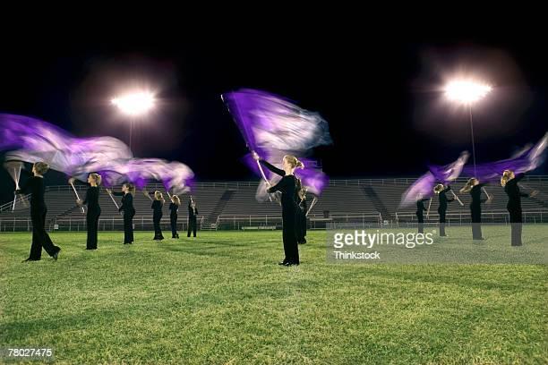 members of the flag team perform during the halftime show. - feierliche veranstaltung stock-fotos und bilder