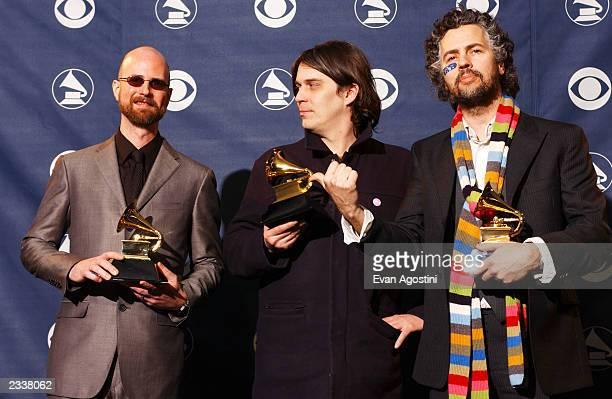 Members of the Flaming Lips pose backstage during the 45th Annual Grammy Awards at the Madison Square Garden on February 23 2003 in New York City