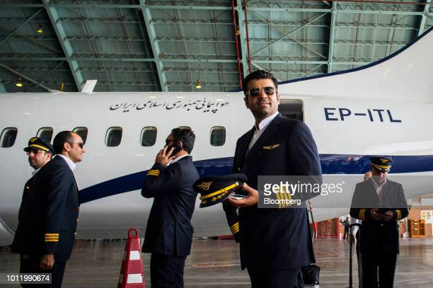 Members of the flight crew disembark a new twin engine ATR 72600 turboprop aircraft following its arrival at Mehrabad International airport in Tehran...