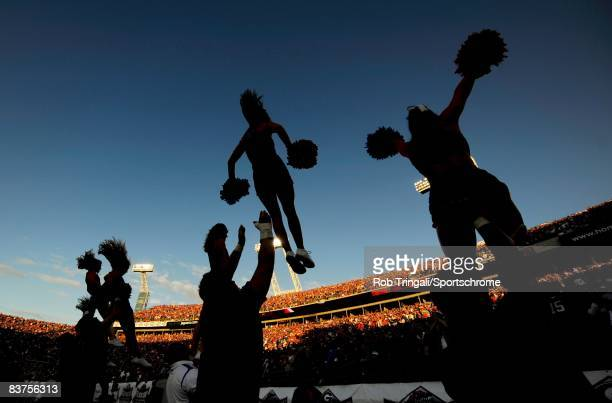 Members of the Florida Gators cheerleading squad performs during a game against the Georgia Bulldogs at Jacksonville Municipal Stadium on November 1...