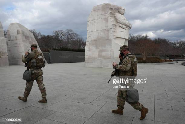 Members of the Florida National Guard walk past the Martin Luther King Jr. Memorial on January 17, 2021 in Washington, DC. After last week's riots at...