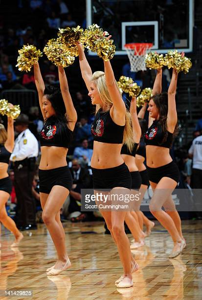 Members of the Florida State Seminoles Cheerleaders perform during a quarterfinal game of 2012 ACC Men's Basketball Conference Tournament against the...