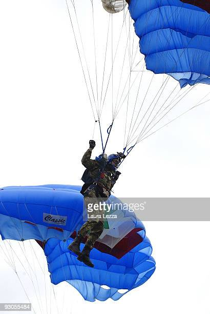 Members of the Folgore Parachute Brigade parachute into the stadium during a ceremony to mark the 67th anniversary of The Battle of El Alamein at...