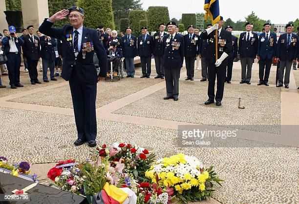 Members of the Folkstone branch of the Normandy Veterans Association gather to pay tribute at the American soldiers' cemetery June 4 2004 at...