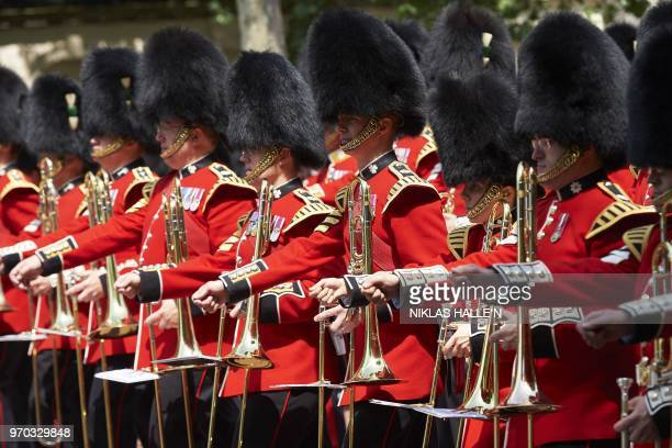 Members of the Foot Guards regimental bands march on The Mall as they accompany the Queen back to Buckingham Palace after attending the Queen's...